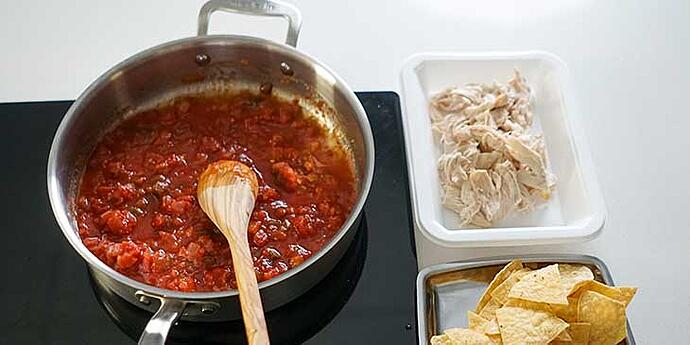 Saute and cook red salsa in hot oil in a stainless steel frypan