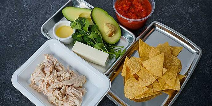 Chilaquiles Chicken Recipe ingredients prepared before cooking and portioned on trays
