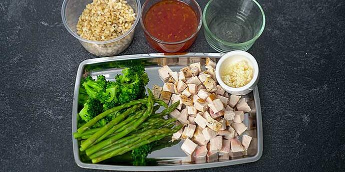 Easy Sweet and Sour Chicken Recipe ingredients prepared on glass containers and stainless steel tray