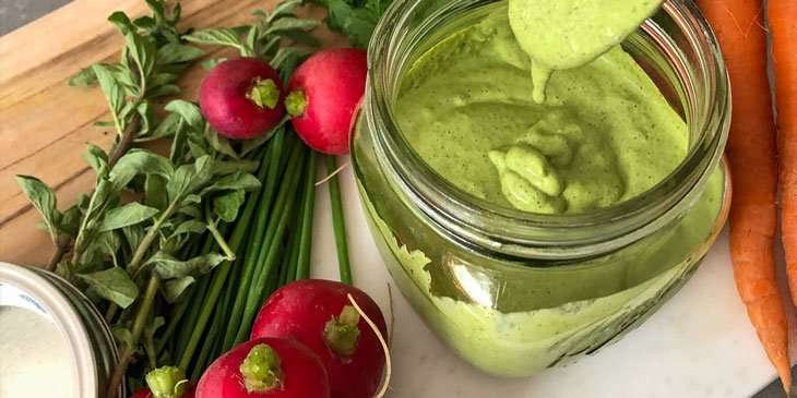 Green Goddess Sauce Recipe served on a round mason jar next to fresh produce
