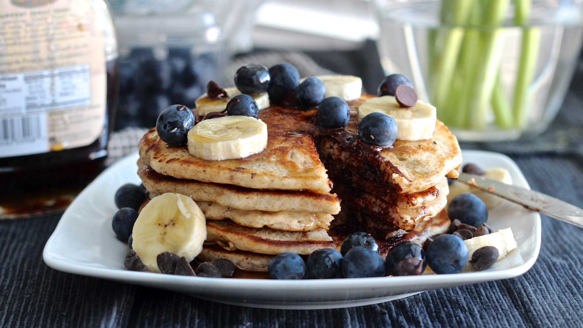 foods-high-in-carbohydrates Homemade-Banana-Chocolate-Chip-Pancakes-with-Fresh-Fruit-521150-edited