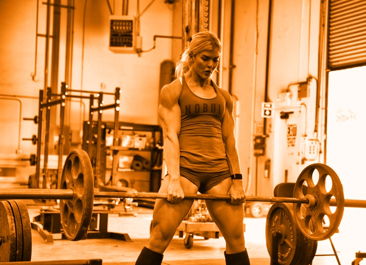 Image of Brooke Ence lifting a heavy barbell