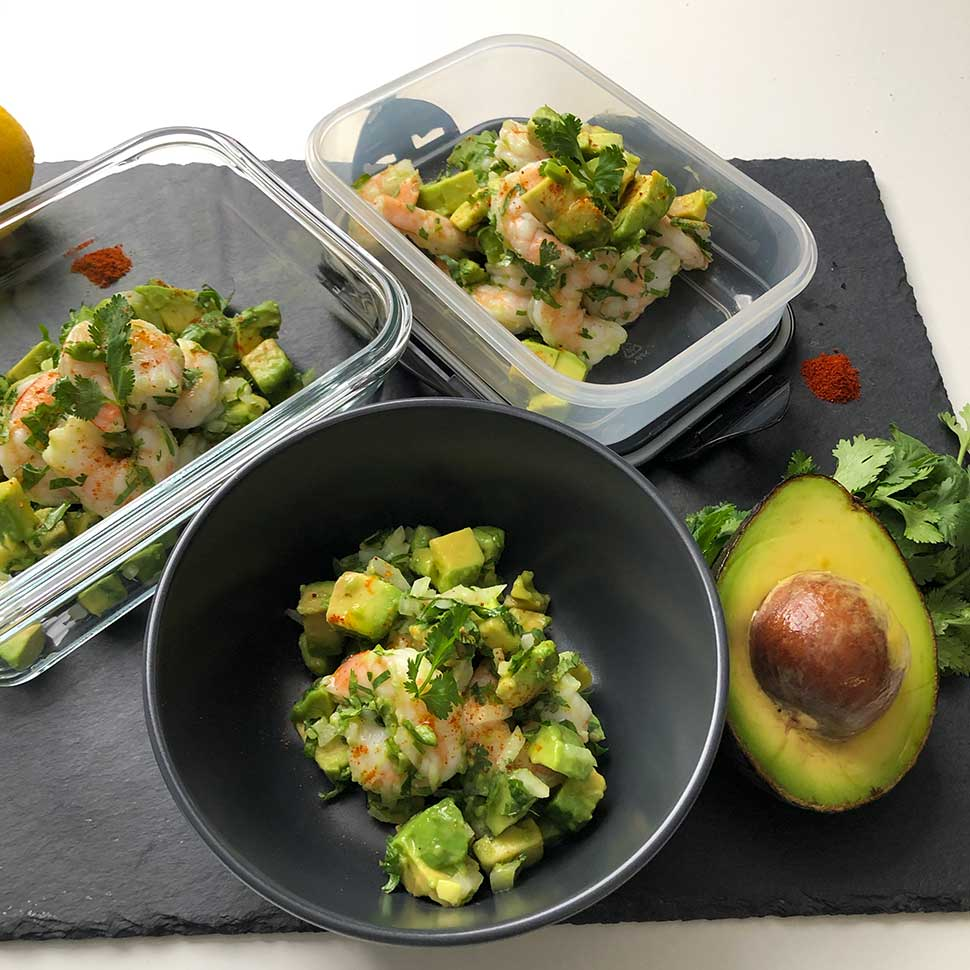 keto-shrimp-avocado-salad-on-meal-prep-containers-in-a-black-background