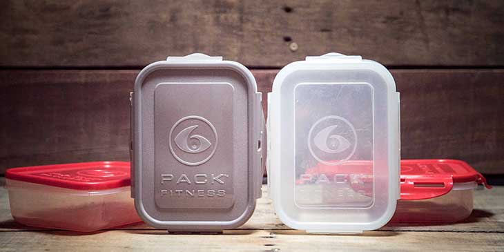 6-pack fitness meal prep containers placed on a wood background