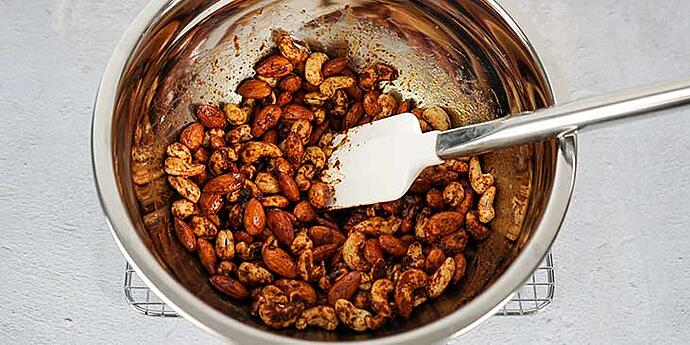 Paleo Roasted Spiced Nuts Recipe add spices to nuts