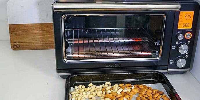 Paleo Roasted Spiced Nuts Recipe roast nuts in Breville oven