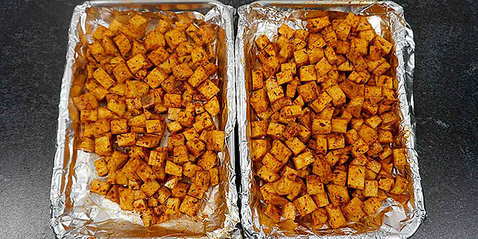 Cook seasoned Sweet Potato on sheet trays