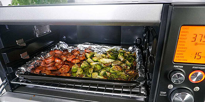 Cook sausage and brussels sprouts