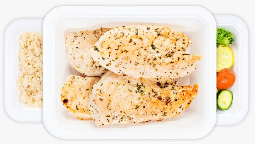 Tray of lightly seasoned, ready to eat Trifecta chicken