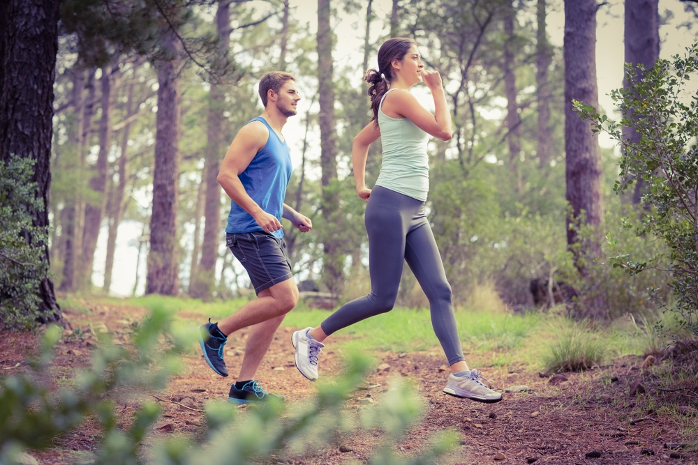 Happy joggers running in the nature