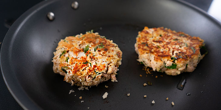 cooking salmon cakes in saute pan