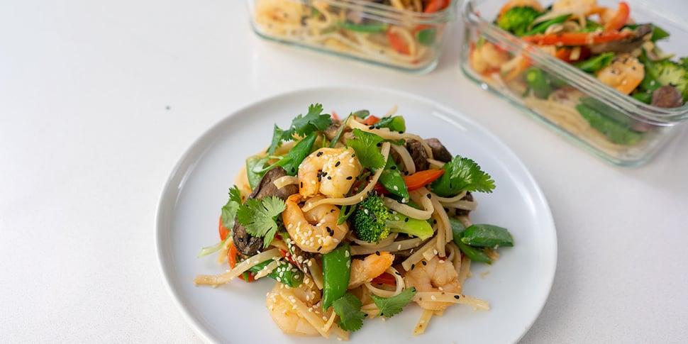 shrimp noodle stir fry on plate for meal prep