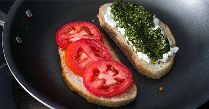 toasting-chicken-pesto-sandwich-ingredients-in-skillet