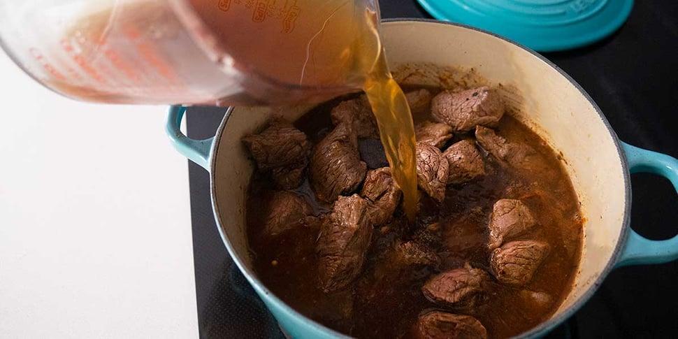 adding stock to keto beef stew recipe