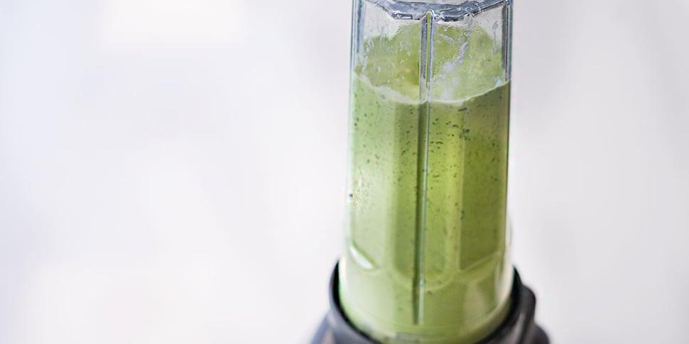 blending keto green smoothie in blender for meal prep