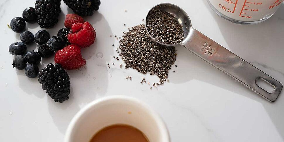 ingredients for chia seed pudding placed on a white background