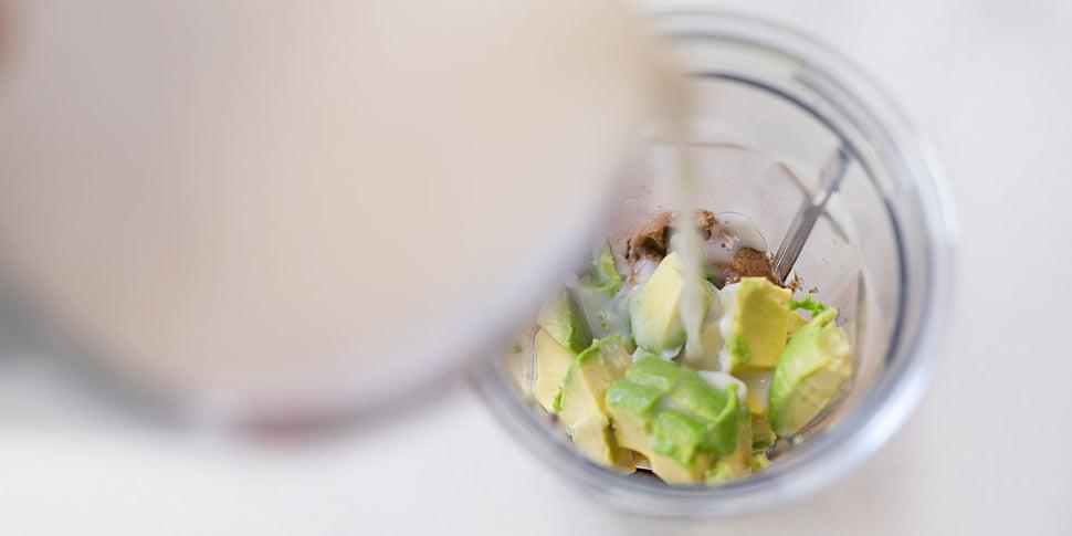 adding coconut milk to keto avocado smoothie recipe