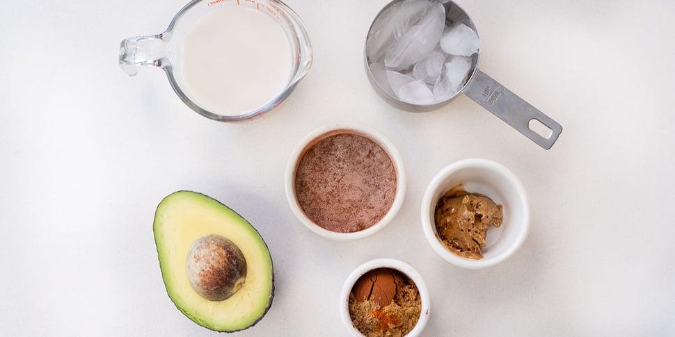 keto avocado smoothie recipe ingredients on white round ramekin containers