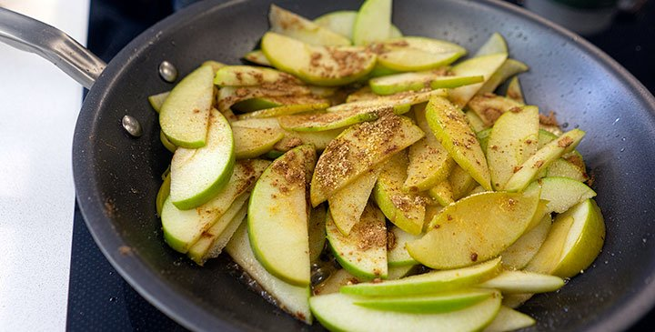 sauting apples and spices for apple crisp recipe