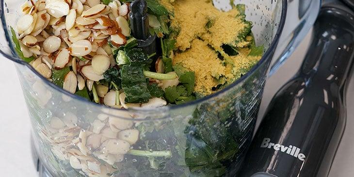 processing kale pesto ingredients in breville food processor