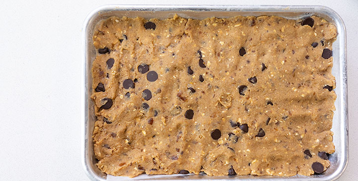 protein cookie dough bar recipe on sheet tray