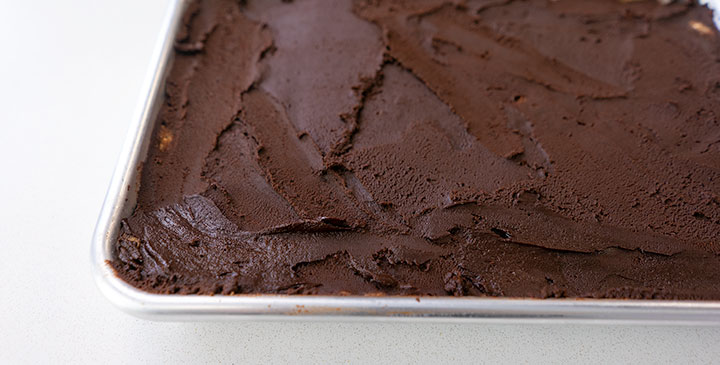 protein cookie dough bar recipe on sheet tray with choclate