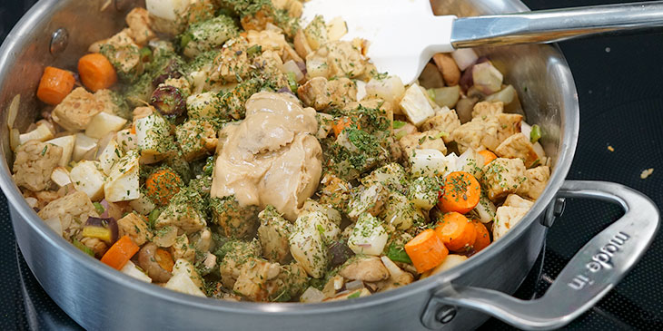 sauteing root vegetables and spices for vegan pot pie recipe