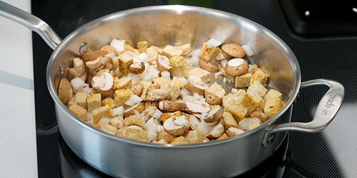 sauteing tempeh and vegetables in pot