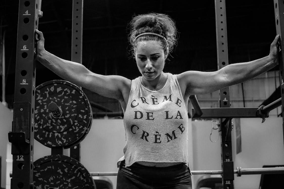 woman weight lifter at gym thinking