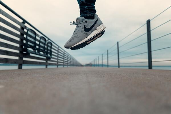 Close up of sneakers and legs mid-jump