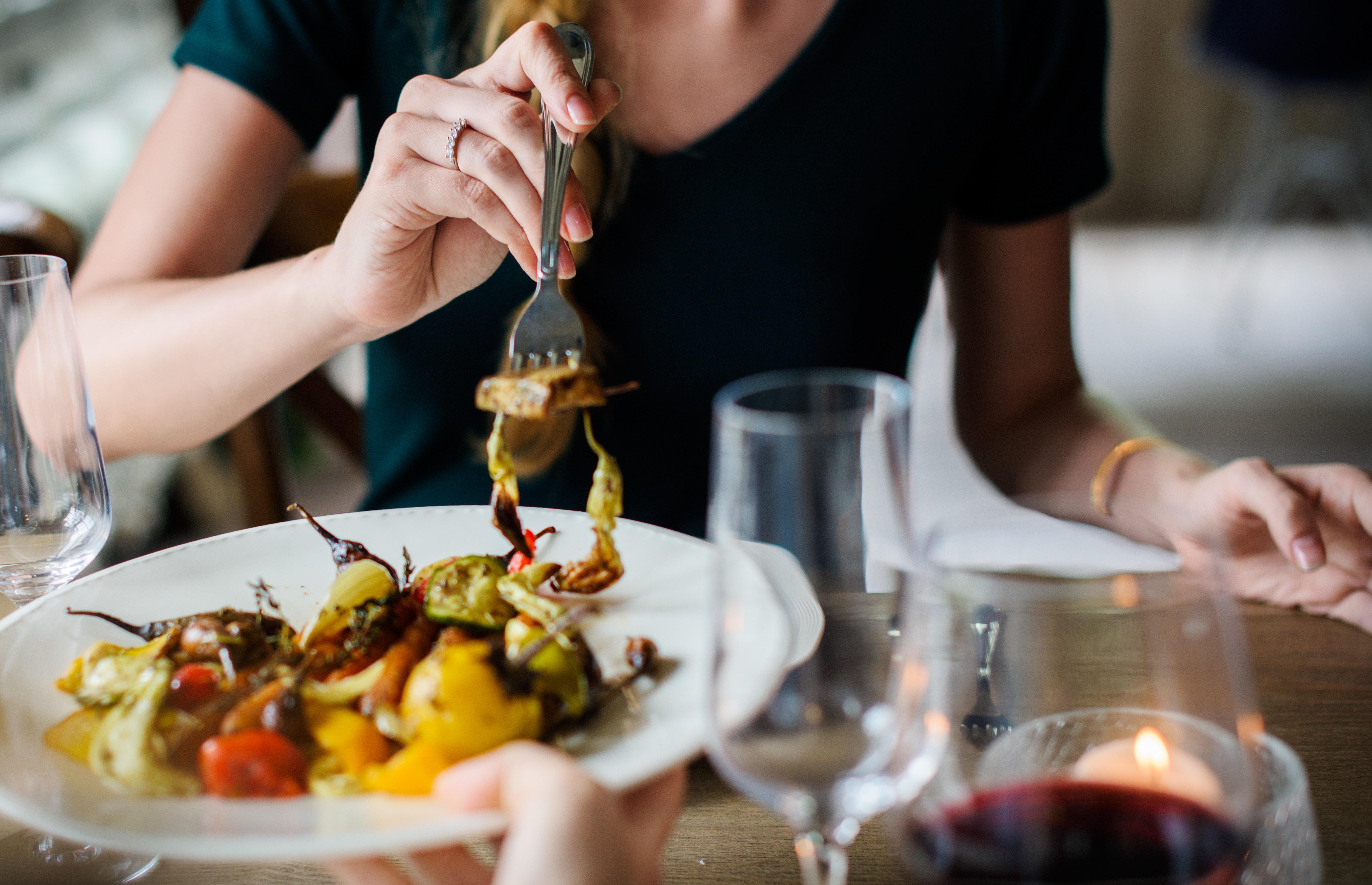 woman eating roasted vegetables