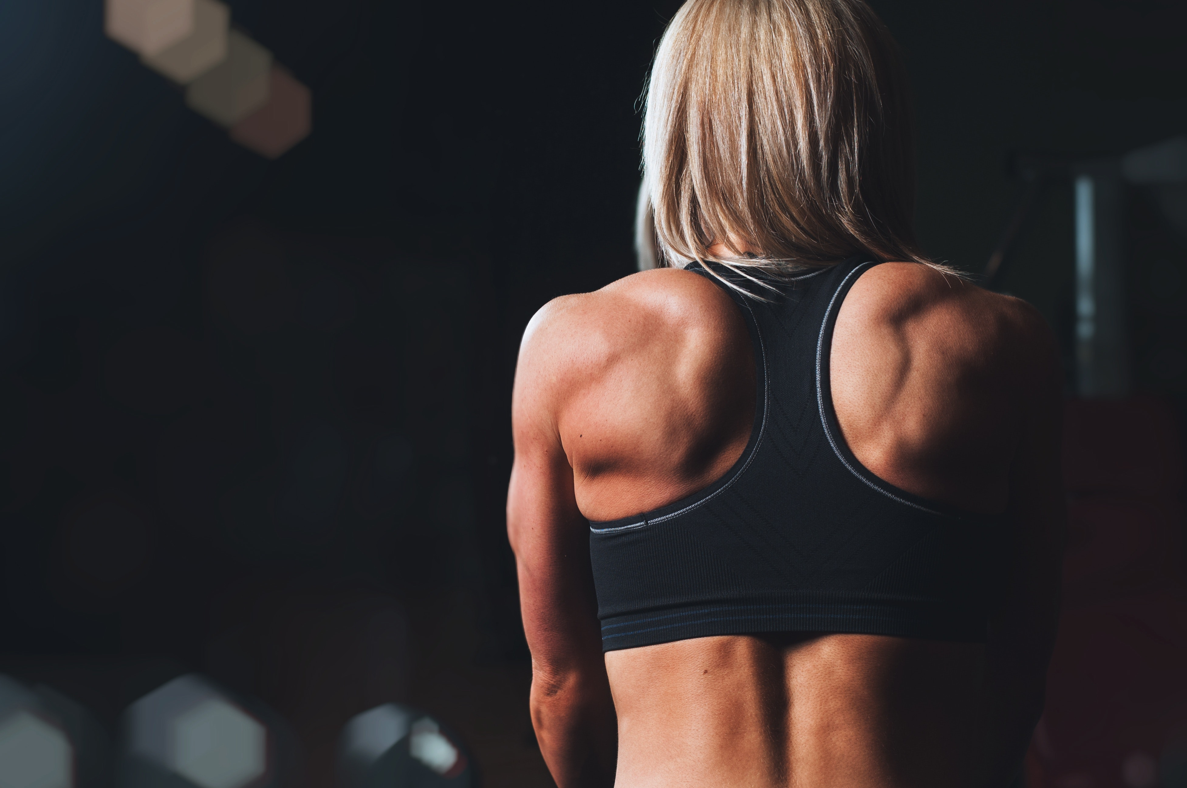 Woman's muscular back doing arm exercises