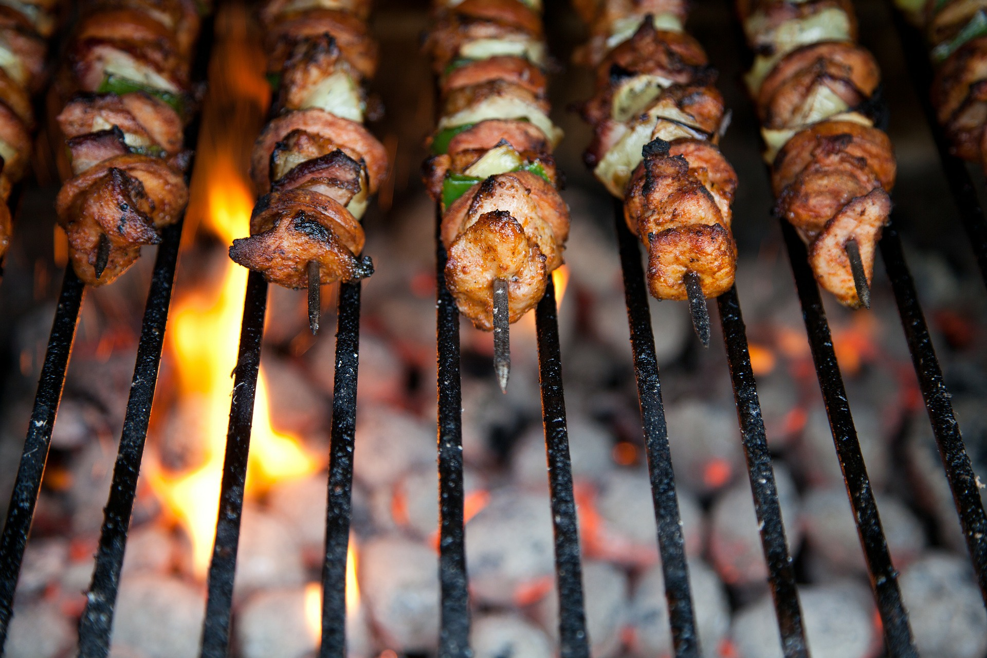 Chicken kebobs on a coal-fired grill