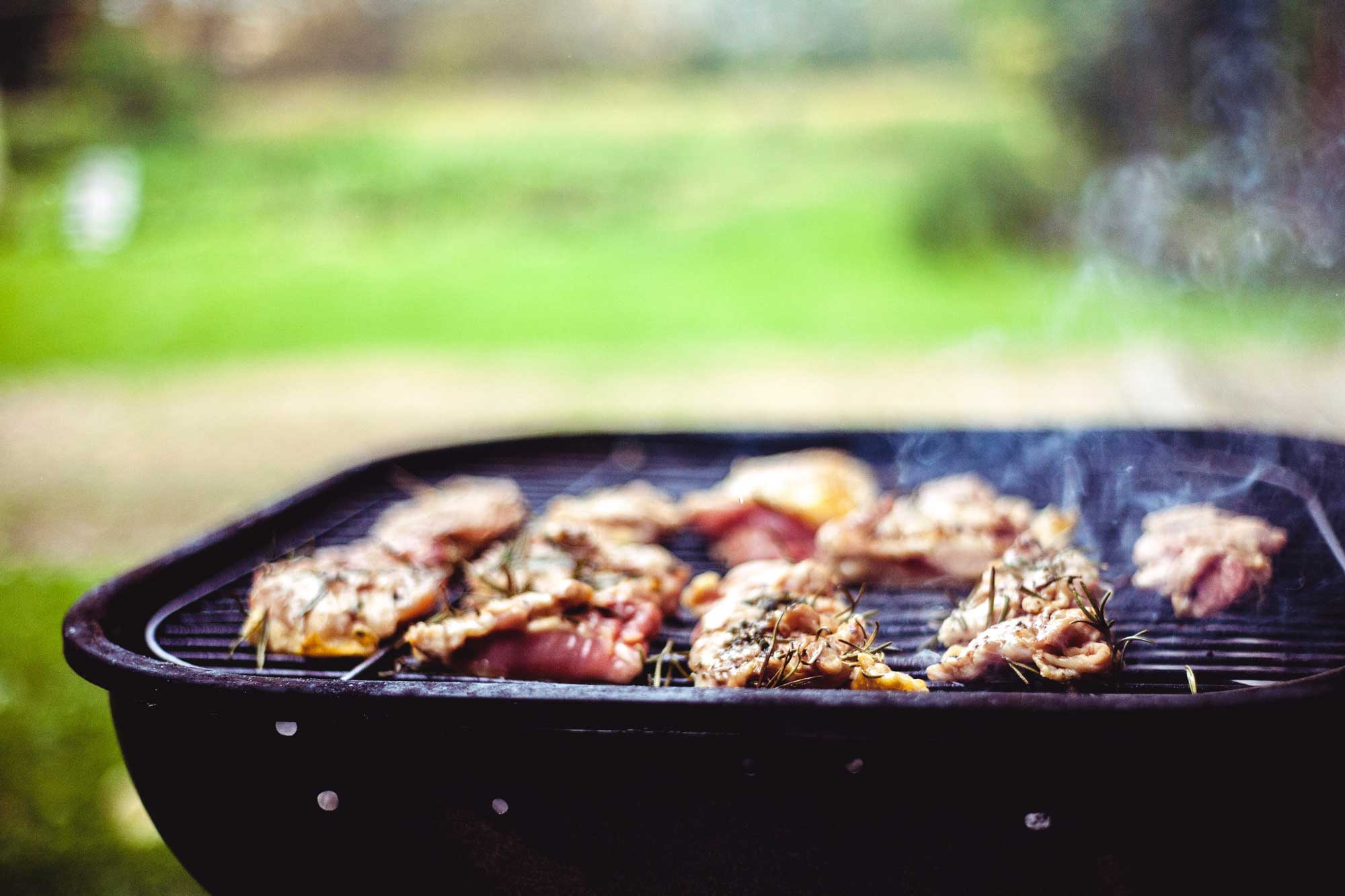 Steaming barbecue beef on an outdoor grill