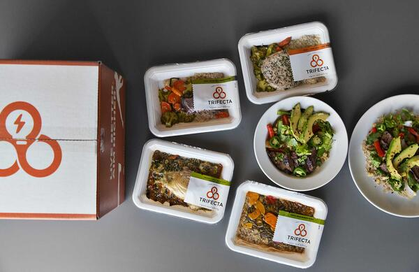 Trifecta box next to packaged Trifecta meals
