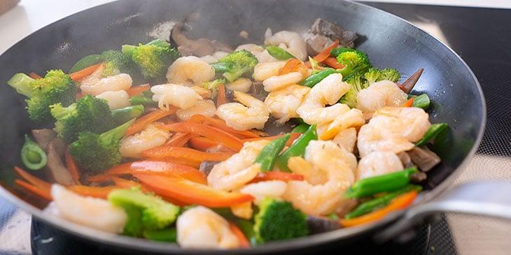 cooking shrimp stir fry in wok