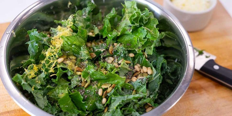 mixing lemon parm kale salad recipe for keto meal prep