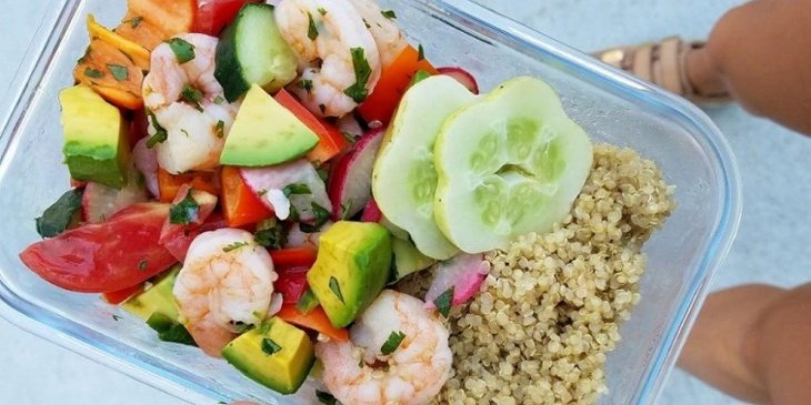 Shrim ceviche recipe plated on a meal prep container with a side of white quinoa