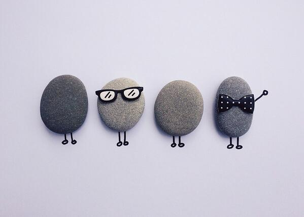 Rocks with cartoon limbs, glasses and bowties