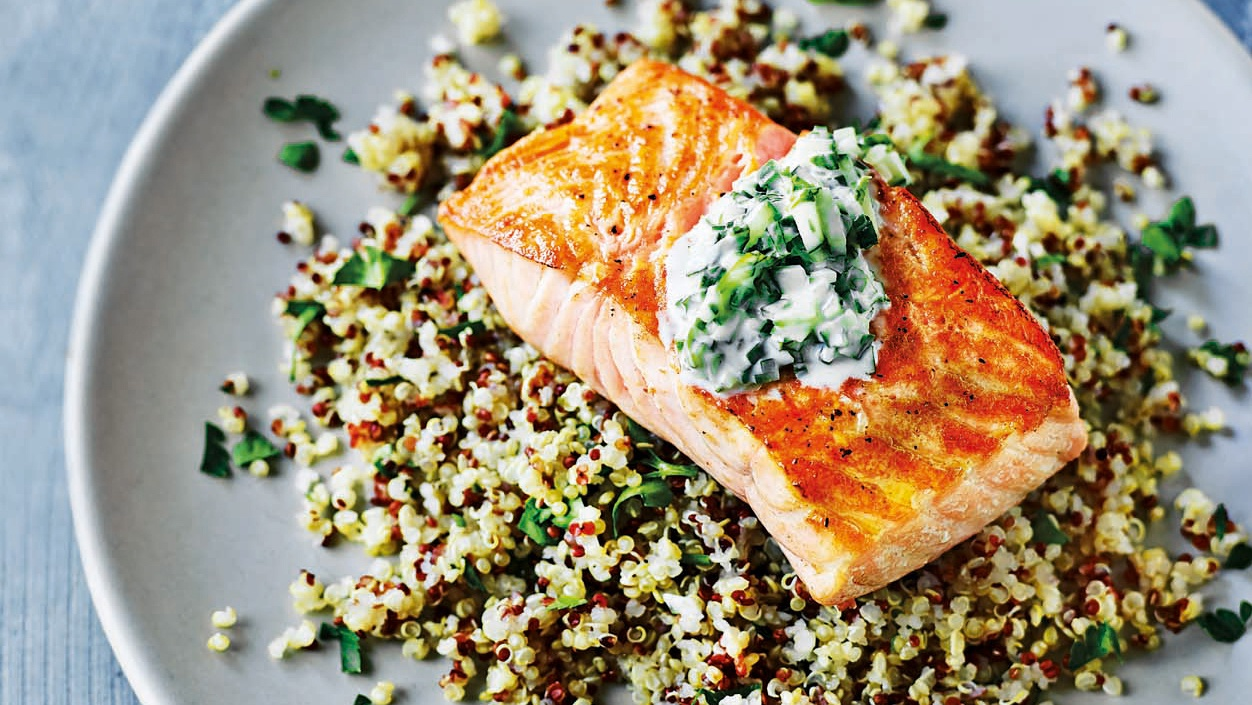 Grilled salmon on a bed of grains