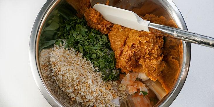 mixing shrimp burger ingredients in bowl