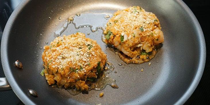 cooking shrimp burgers in saute pan