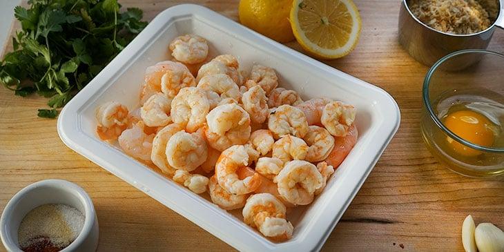 ingredients for crispy shrimp burger on cutting board