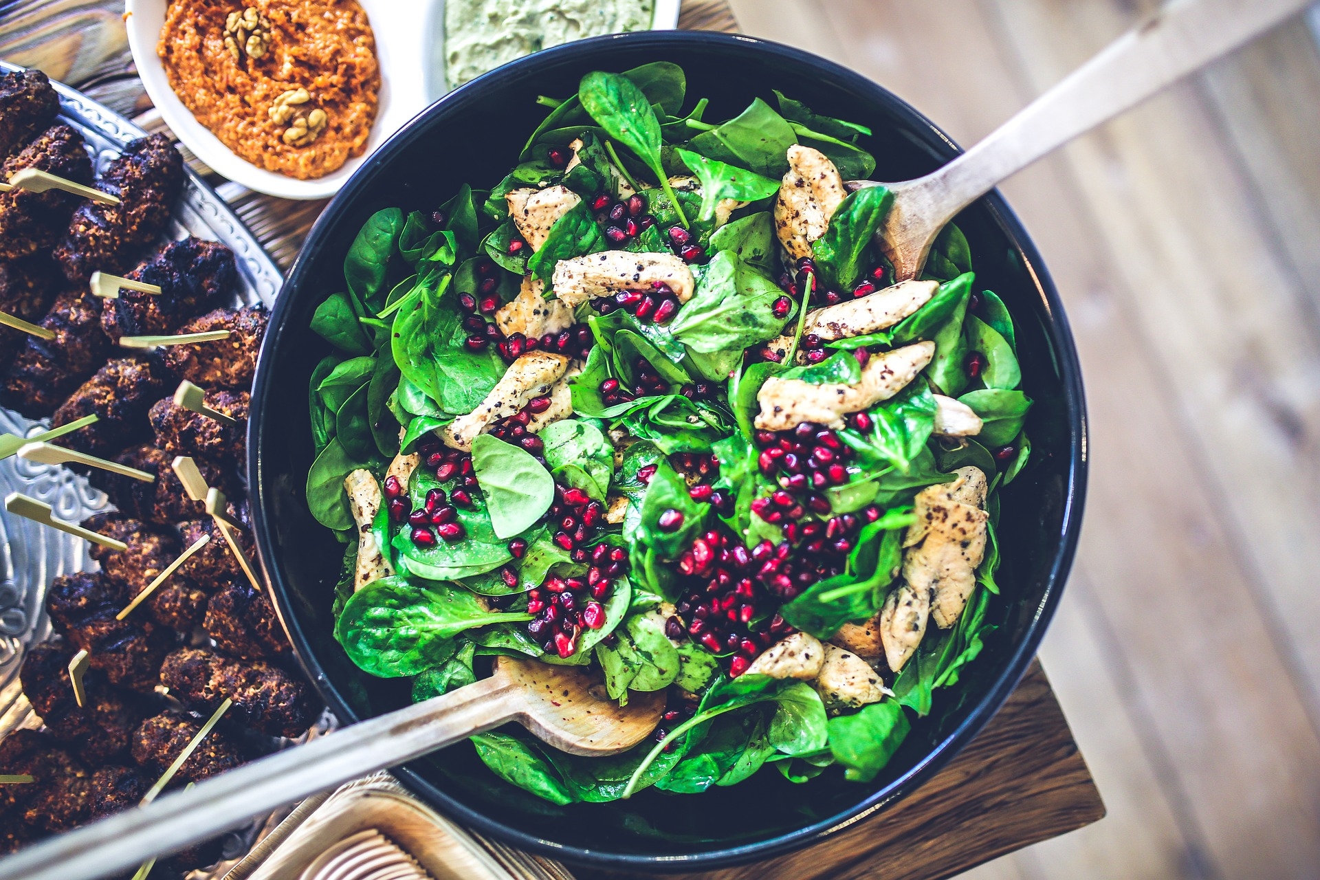 Chicken and spinach salad with pomegranate seeds