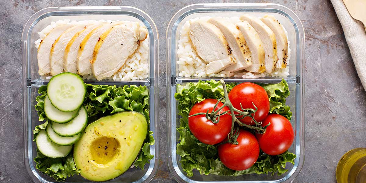 Clean Eating Recipes for Beginners Meal prep containers with chicken rice vegetables and avocado