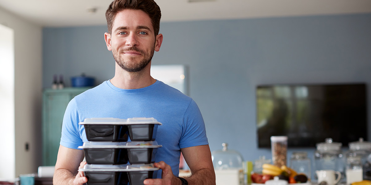 6 Keto Breakfast Recipes to For Low Carb Variety - man holding stack of meal prep containers