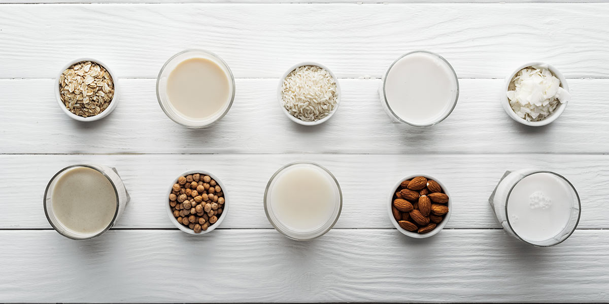Dairy alternatives and ingredients on white tabletop