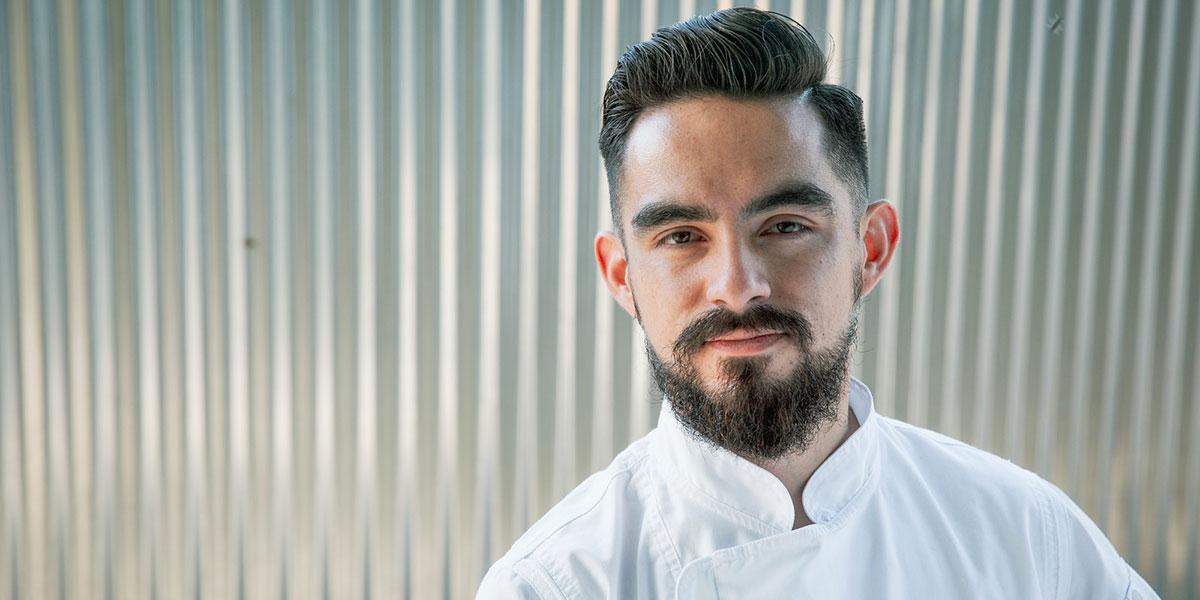 Chef Mario Limaduran wearing chef whites headshot
