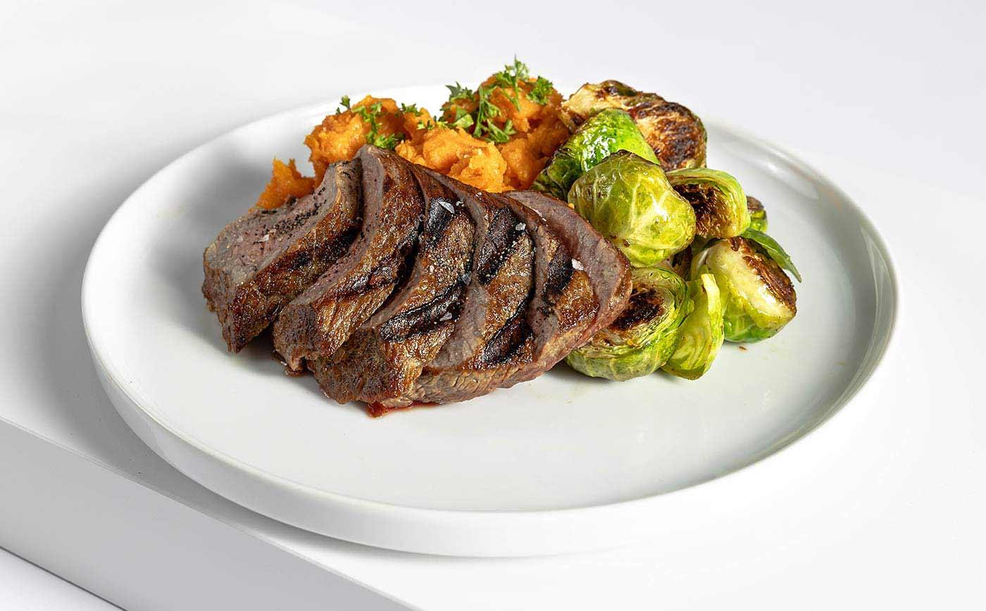 Paleo Meal Grass-Fed Steak Organic Brussels Sprouts and Sweet Potatoes