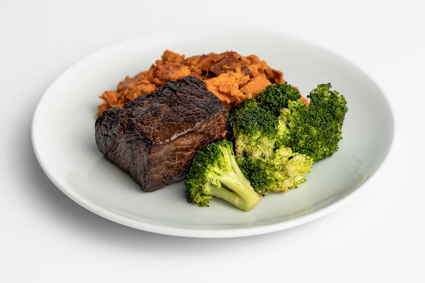 Paleo Meal Delivery Grass-Fed Steak with Mashed Sweet Potatoes and Broccoli